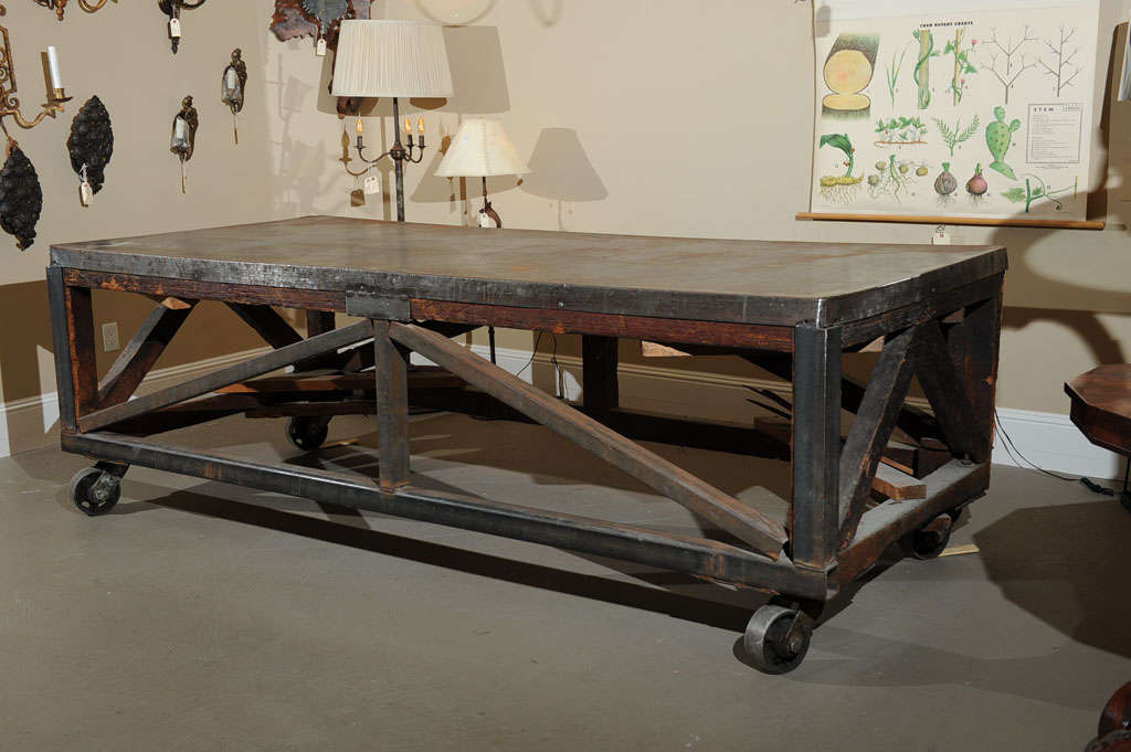American 19th Century Industrial Steel Encased Redwood Wheeled Table For Sale