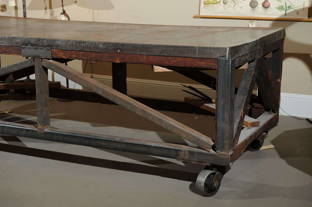 19th Century Industrial Steel Encased Redwood Wheeled Table In Good Condition For Sale In San Francisco, CA
