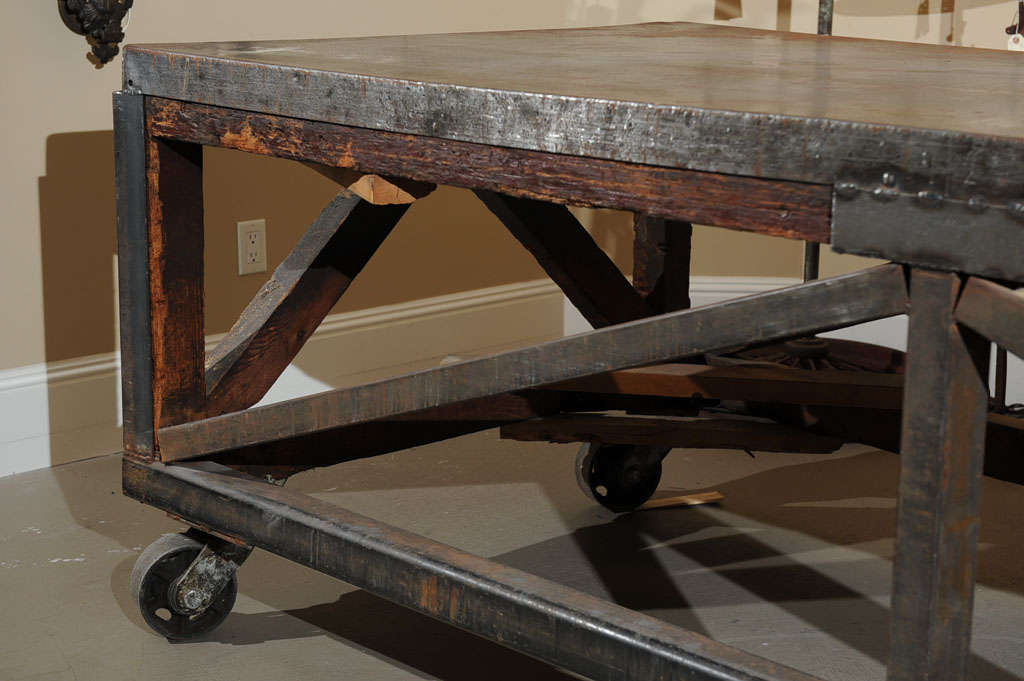 19th Century Industrial Steel Encased Redwood Wheeled Table For Sale 2