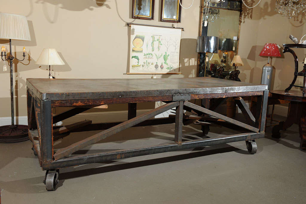 A truly exceptional piece of California history, this Redwood and steel work cart was used to transport steel from horse and wagon at 248 Utah Street in San Francisco. The table top is steel over wood panels. The exposed wood legs and armature has