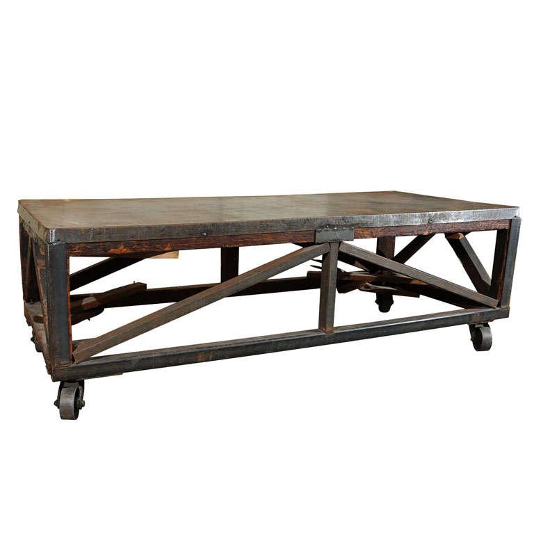 19th Century Industrial Steel Encased Redwood Wheeled Table