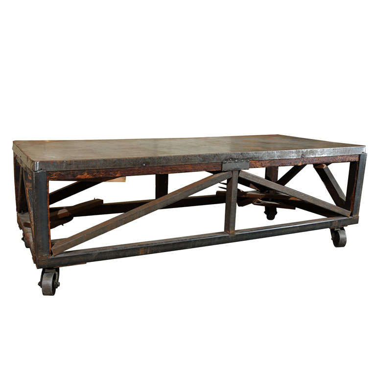 19th Century Industrial Steel Encased Redwood Wheeled Table For Sale