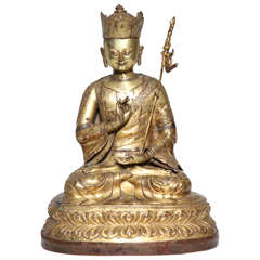 A 17th- 18th Century Tibetan Gilt Bronze Crowned Seated Buddha