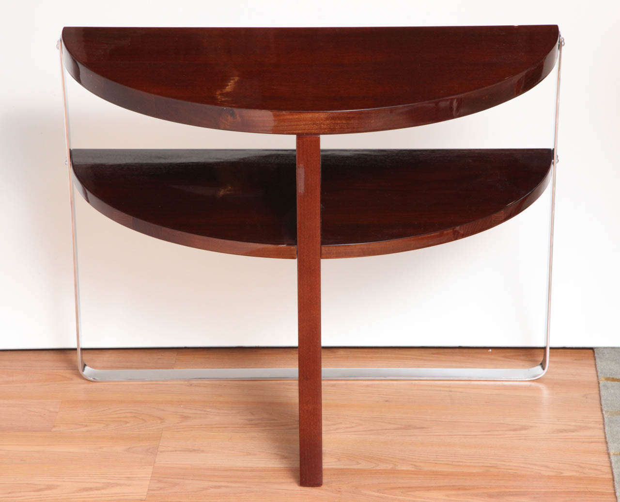 Pair of Machine Age Art Deco side tables in the style of Donald Deskey.