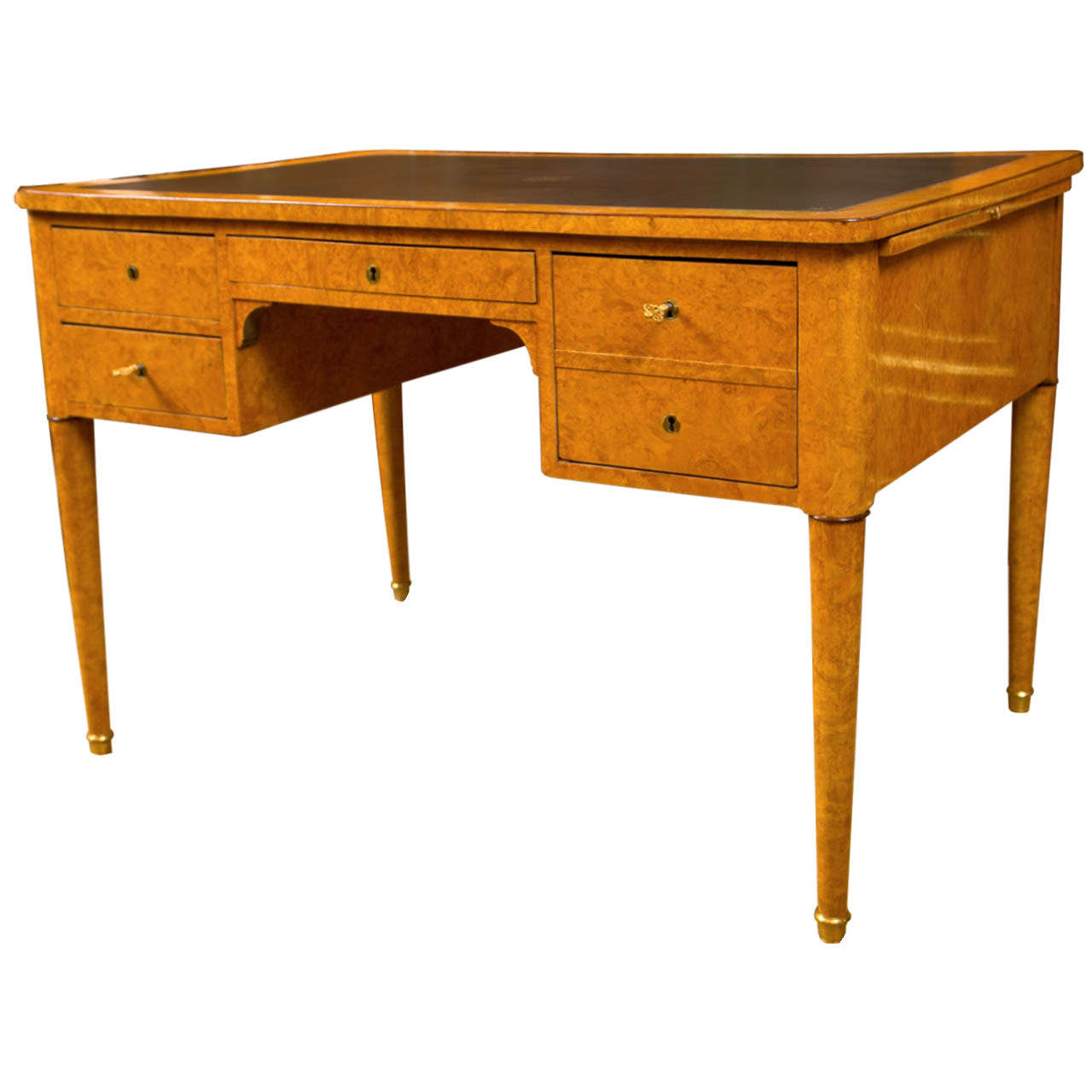 A French Charles X desk or bureau plat with barr ash and amaranth with a leather top. Great quality and secure inner compartments.