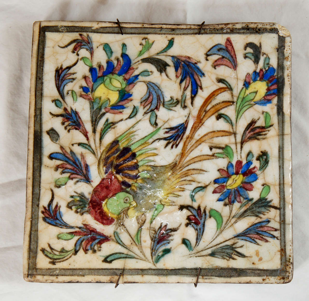 A Persian hand-painted Terra Cotta Tile