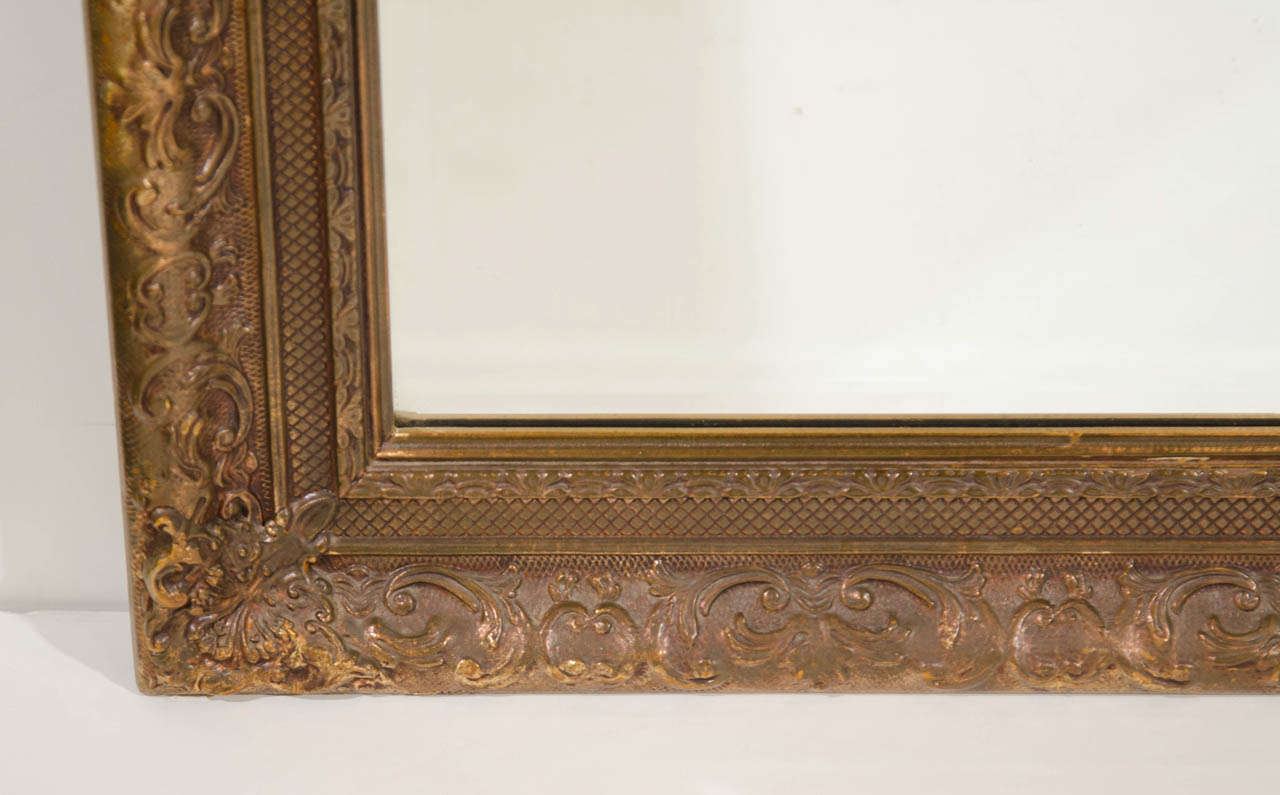Elegant Large Italian Antiqued Gilt Wood Mirror With Hand Carved Frame In Excellent Condition For