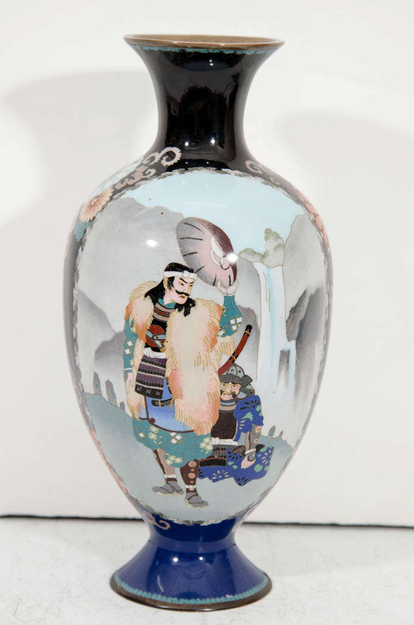 A Meiji Period Japanese Cloisenne vase with figures of Samurai on one side, and floral decoration on the other.