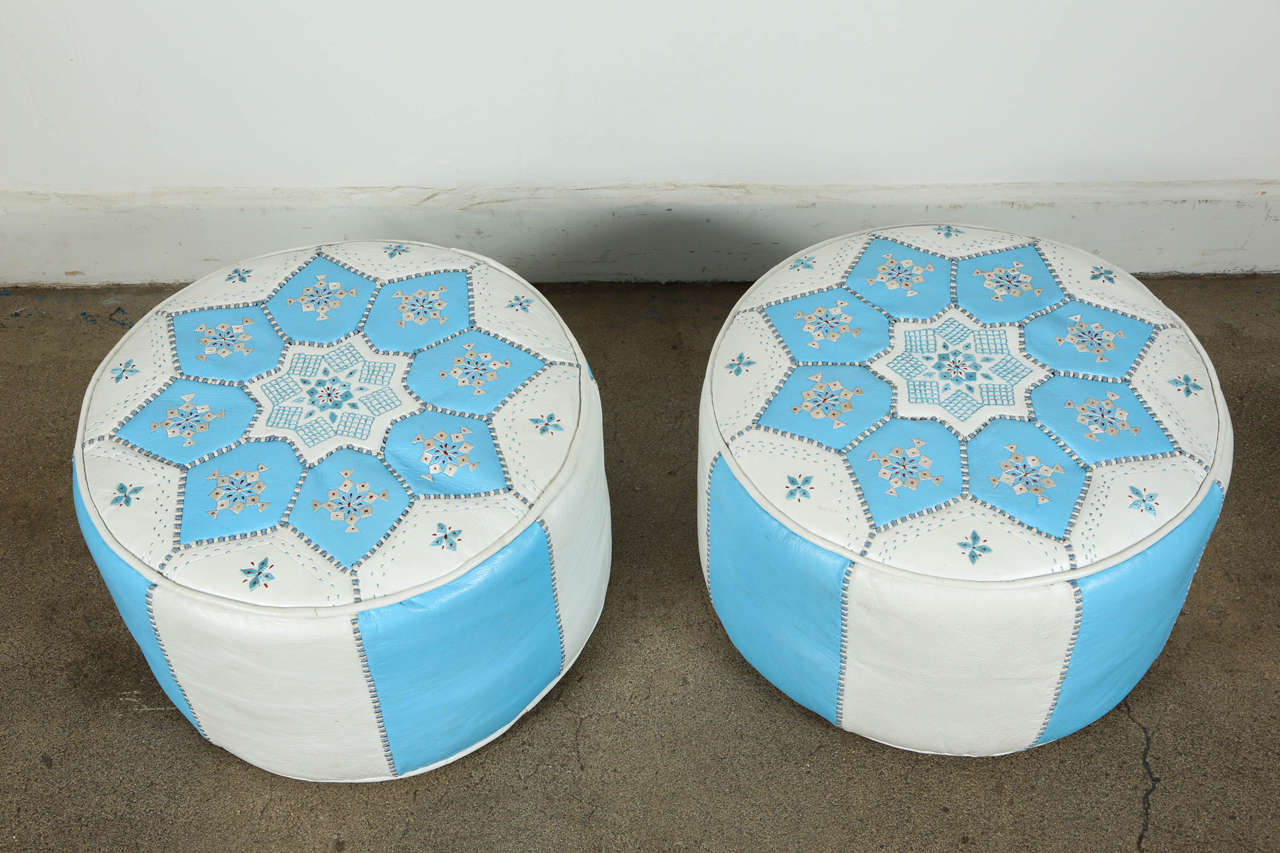 Handcrafted pair of hand-stitched leather Moroccan poufs, in turquoise blue and white, hand embroidered with star designs. High quality white and Tiffany blue round leather ottomans filled with hard foam, great for a kids room to sit on as a stool,