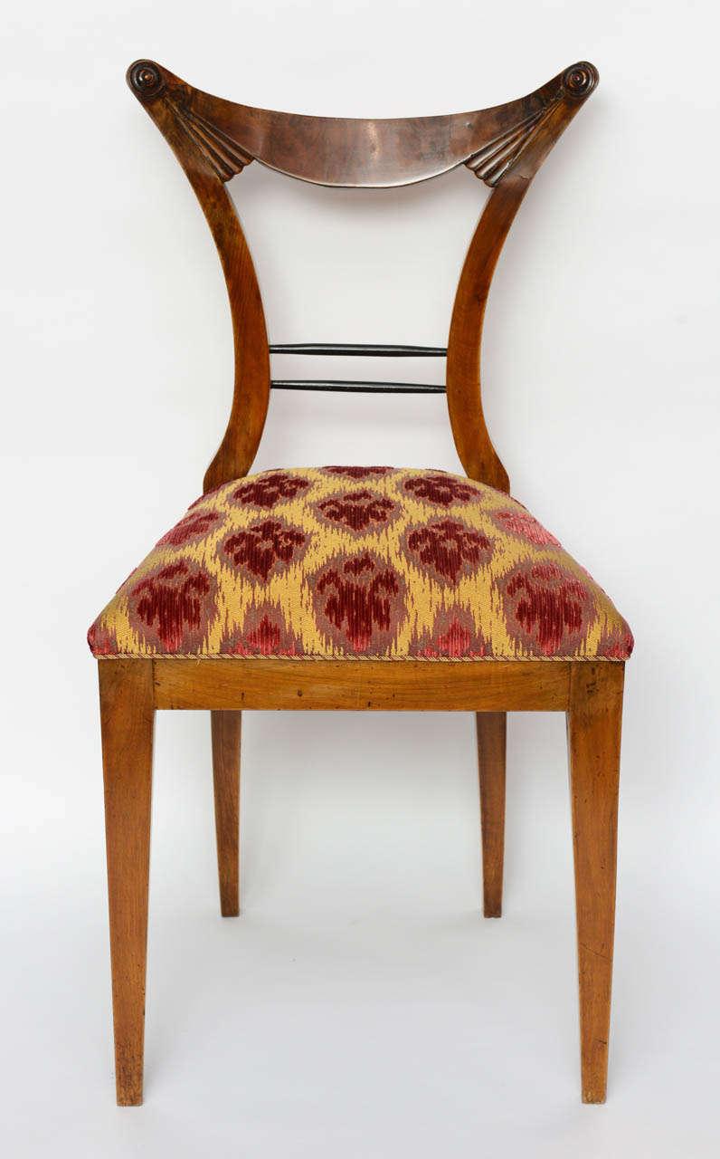 Set of six Biedermeier dining chairs, Josef Danhauser, Vienna. The stylized back over paring legs.