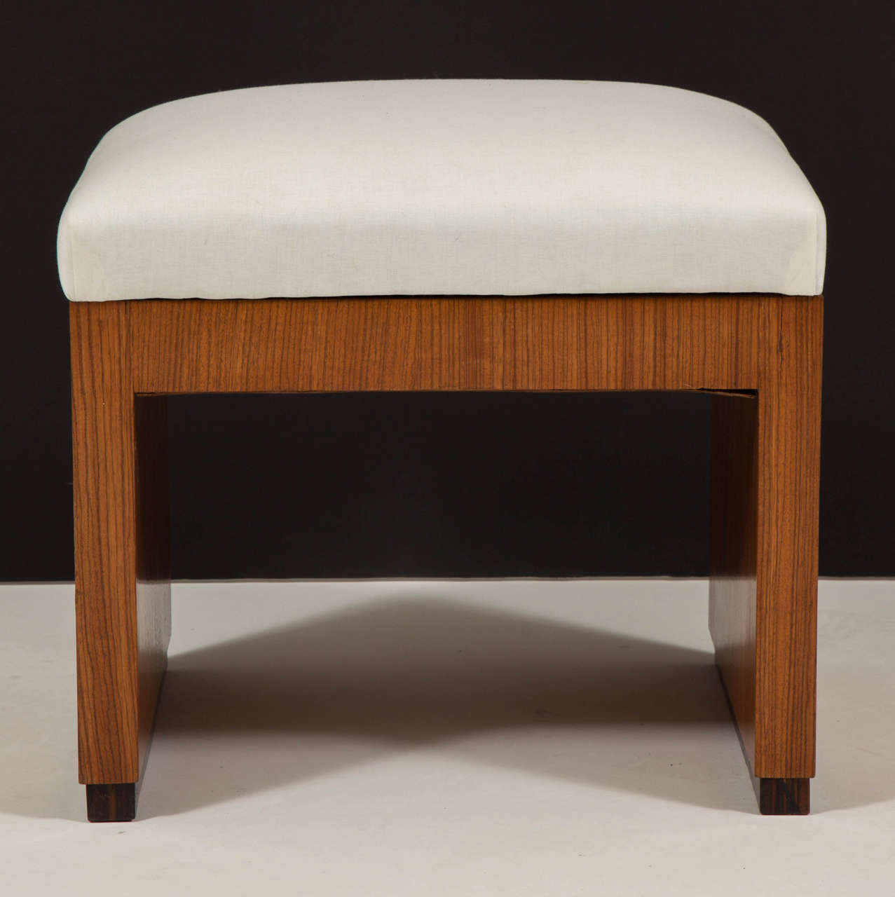 Early 20th century Art Deco style palisander bench, upholstered seat on rectangular base.