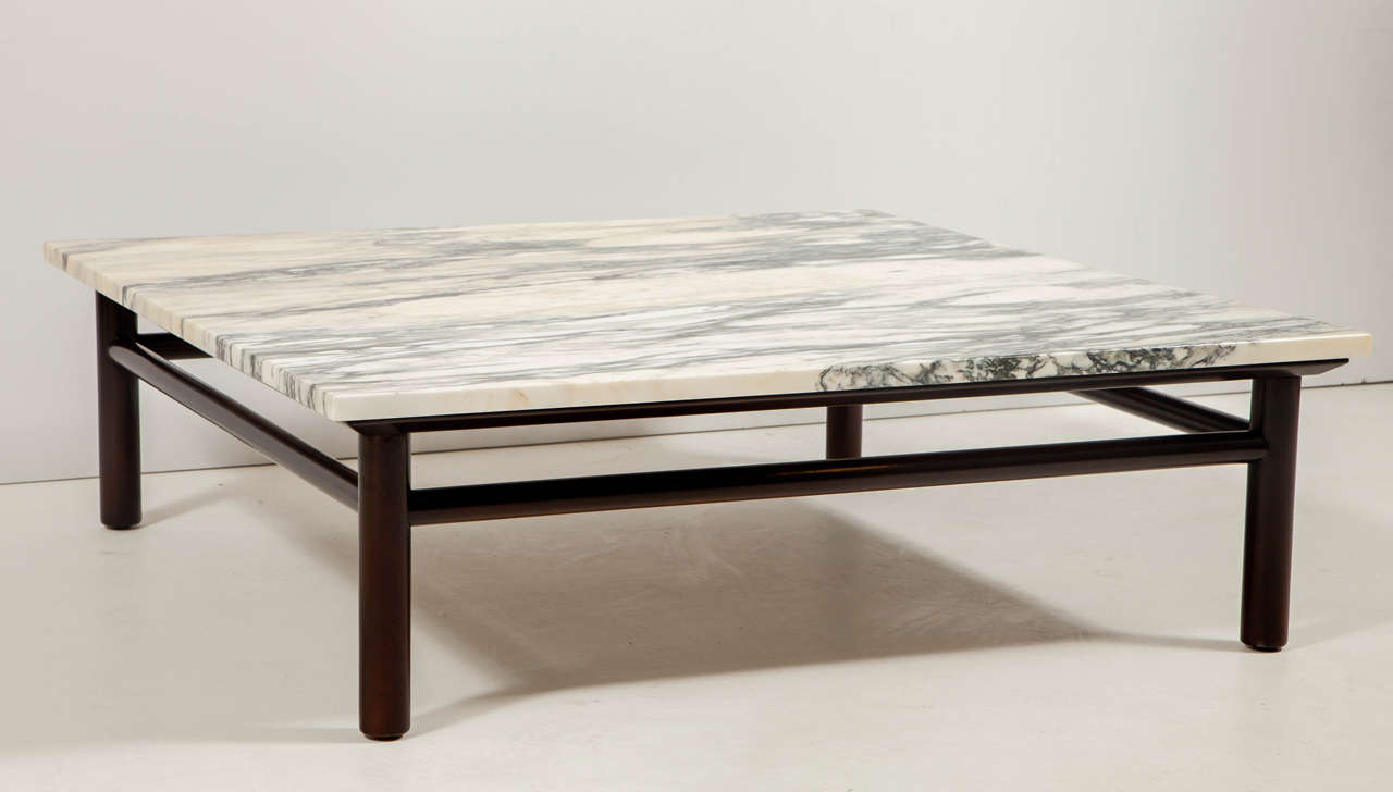 Mid-Century classic dark brown stained Walnut dowel framed coffee table with original creamy white marble top with tonal grey and honey tones. On display at 1stdibs at NYDC, 200 Lexington Ave.