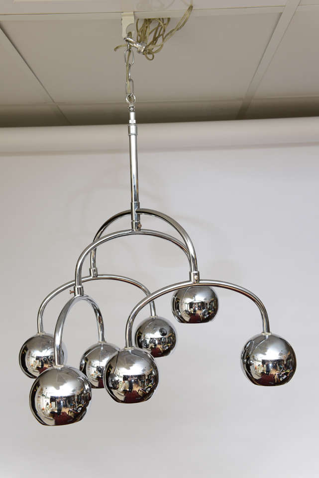 Robert Sonneman seven-light chrome tiered chandelier. There is movement and illumination in this beautiful chandelier.