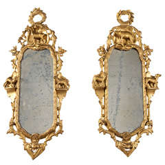 A Pair of 18th c. Giltwood Mirrors with Farm Animal Figurines
