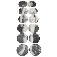 "Mid Century Set of Twelve ""Eva"" Plates by Piero Fornasetti"