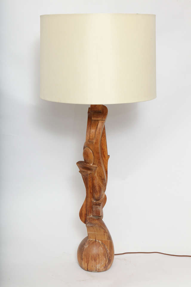 A 1940s Italian Futurist hand-carved wood table lamp. Shade not included