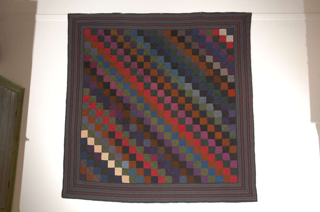 PENNSYLVANIA AMISH WOOL ONE PATCH OR STRAIGHT FURROWS FROM SUMMERSET COUNTY, PENNSYLVANIA.THIS ALL WOOL QUILT HAS GREAT GEM TONE COLORS.THE STRIPED BORDER IS WOOL CHALIS SUITING FABRIC AND UNUSUAL FOR THE AMISH TO USE IN THEIR QUILT MAKING.THIS IS