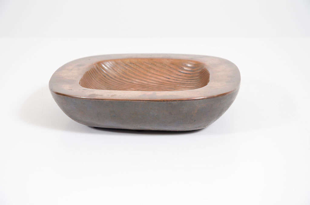 A shallow copper dish in a square form with softened corners and a grooved interior. By Ben Seibel for Jenfredware. American, circa 1950.
