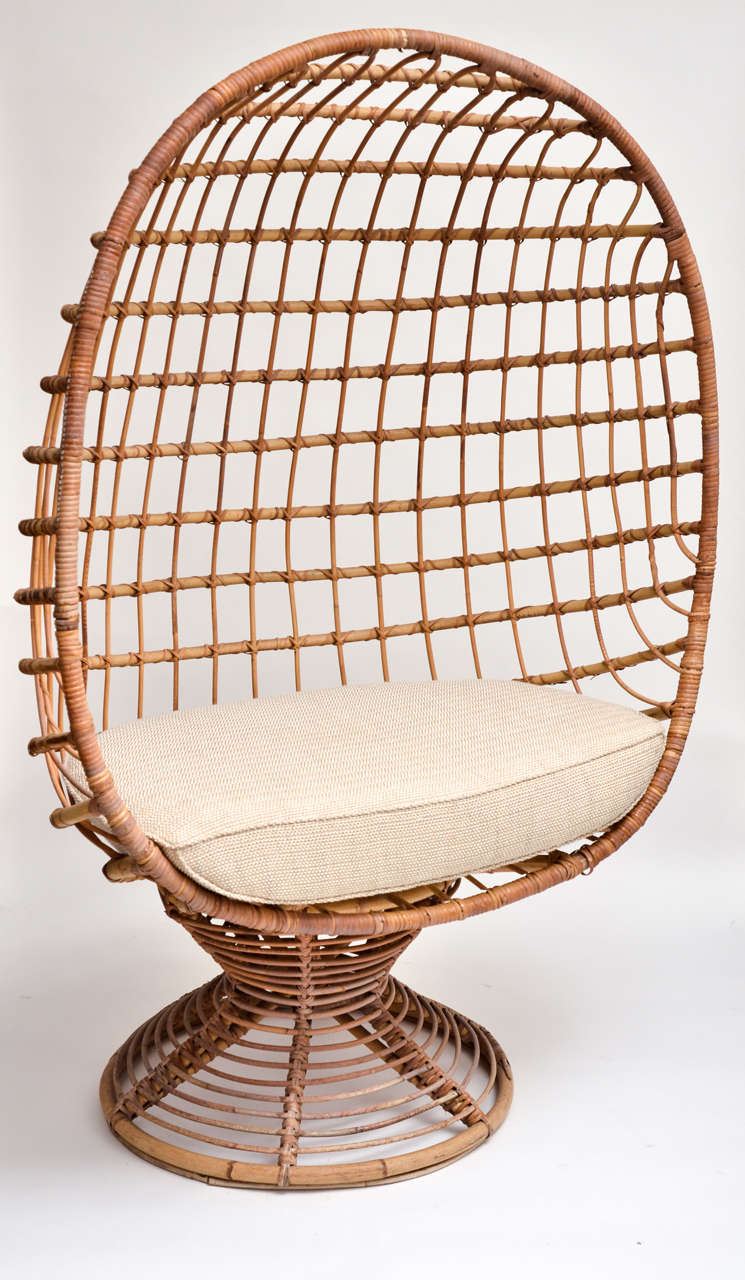 Enclosed woven bamboo canopy chair with upholstered seat cushion.