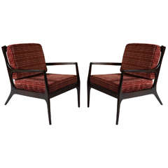 a pair of Danish 1970s walnut armchairs (2)