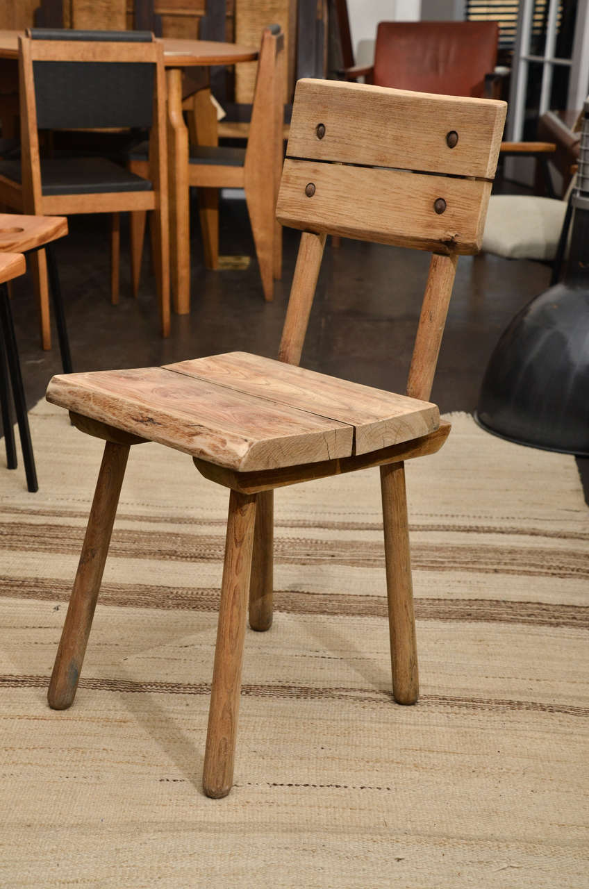 Set of six rustic French chairs with slatted backs and seats.