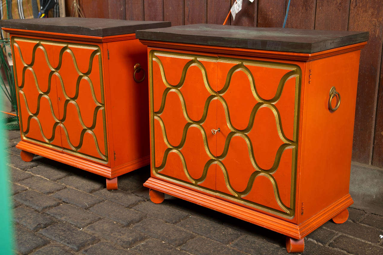 Stunning pair of Dorothy Draper designed Heritage, Henredon chests in original orange and gold finish. Tops are slate.