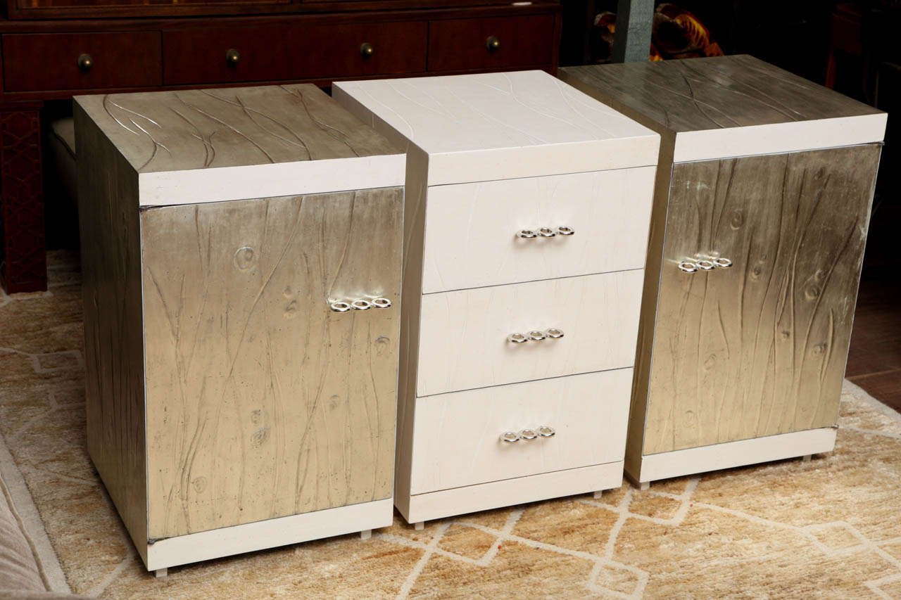 Set of three Martin Feinman multiplex modern cabinets for Modernage, made by Winchendon, circa 1940 the three-drawer cabinet is flanked by two single door cabinets, each with one central shelf. This trio of cabinets has been re-conceived by artist