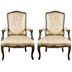 Pair of French Fauteuils Louis XV Style Armchairs Ebonized And Parcel Gilt