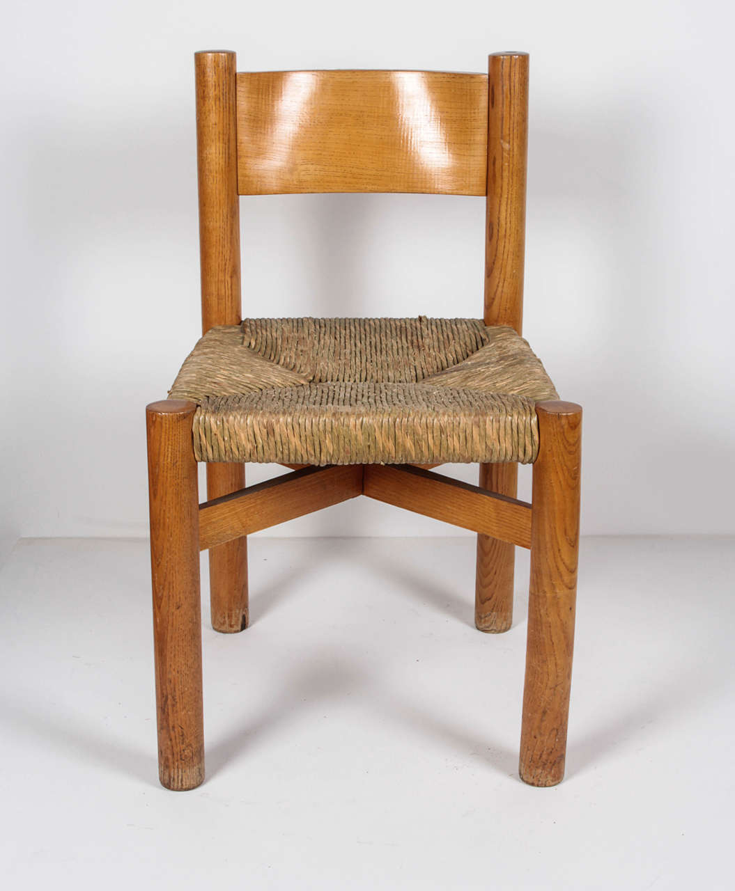 Charlotte Perriand, circa 1967. Chair in oak with rush seat.