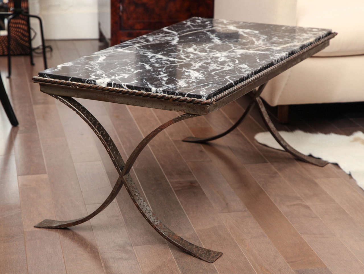 Marble top cocktail table with hand forged iron base at for Forged iron table base