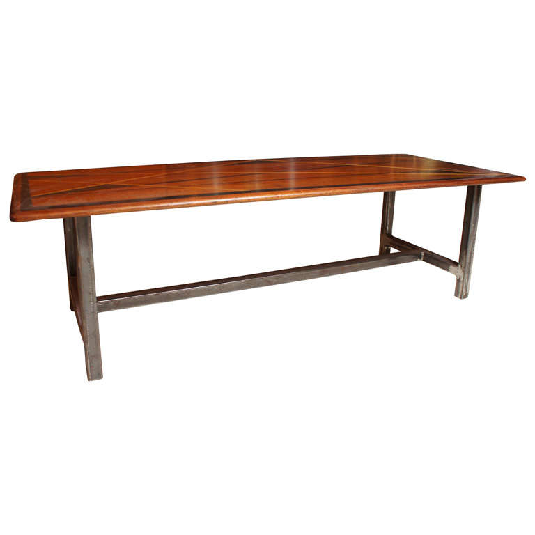 Coffee table with handsomely inlaid top of exotic woods in geometric patterns.  Recently added metal base.