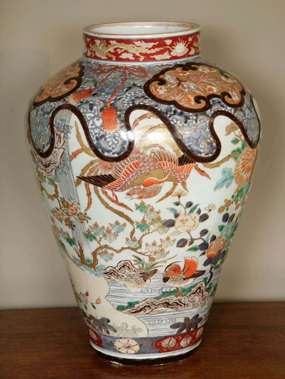 A spectacular and huge early 18th century Japanese Imari vase, circa 1700 showing a plethora of exotic birds such as ducks, pheasants, phoenixes and birds of paradise. All set in a landscape with waterfalls, ponds and rocks. Decorated throughout