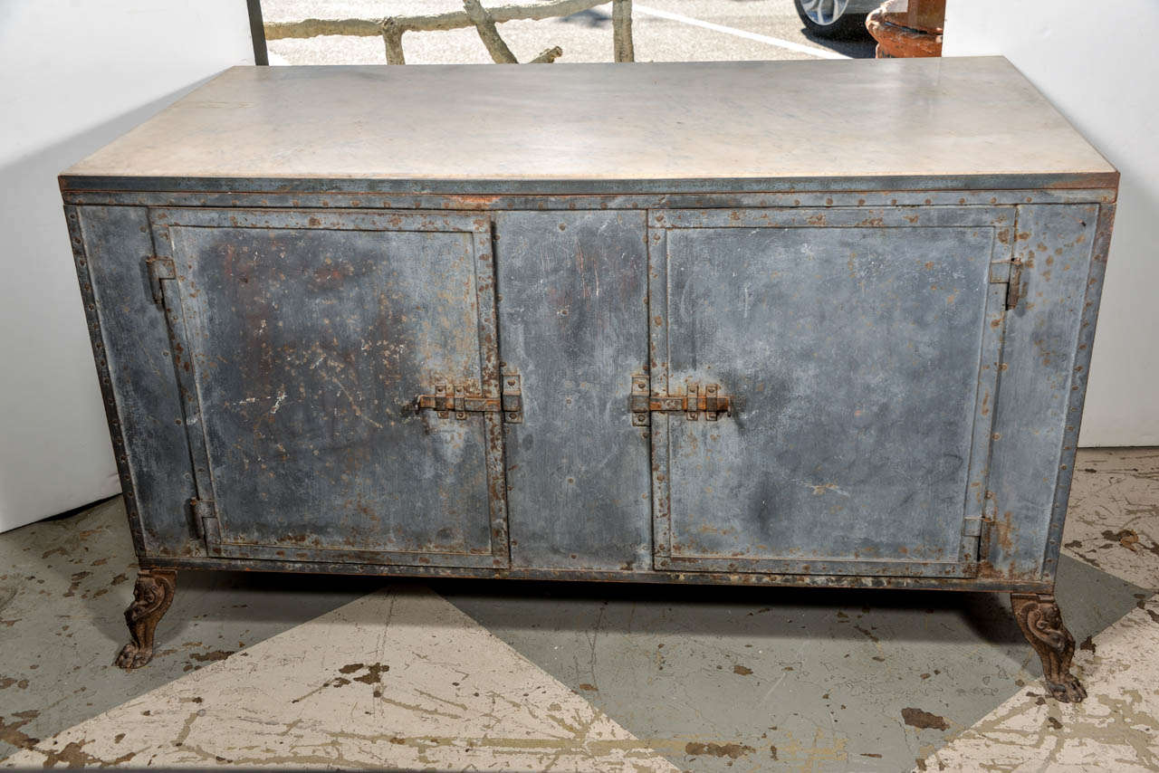 Italian metal cabinet with honed marble inset top, very unusual legs,