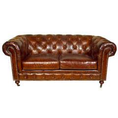 A English Leather Chesterfield Sofa, Sette. One of Two