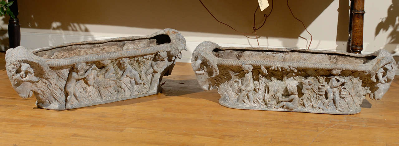 This is a gorgeous pair of cast iron planters believed to have come from Marie Antoinette's farm, L'Hameau de la Reine.  L'Hameau is located on the grounds of Versailles.  It was considered Marie Antoinette's place of escape.  These cast iron