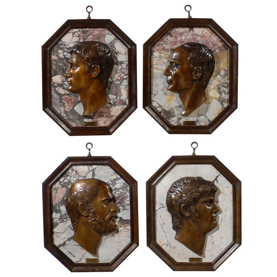 Superb set of four bronze and marble plaques depicting Roman emperors