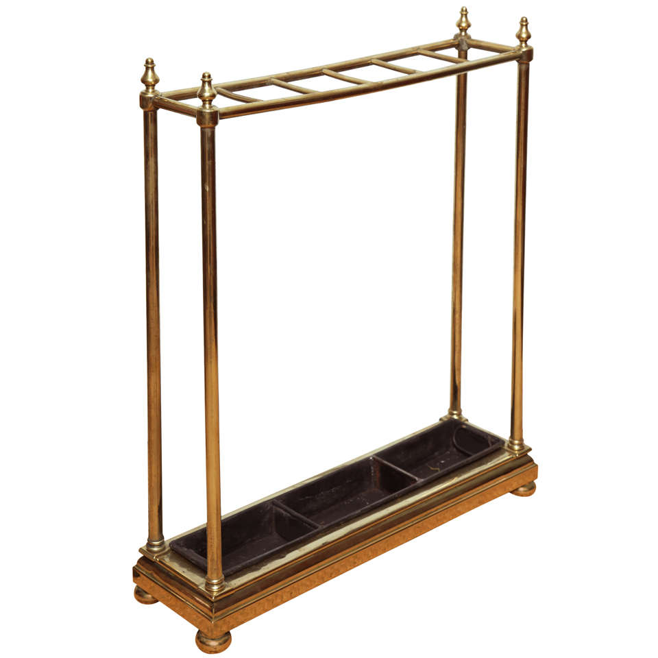 six slot brass umbrella stand with cast iron drip pan at. Black Bedroom Furniture Sets. Home Design Ideas