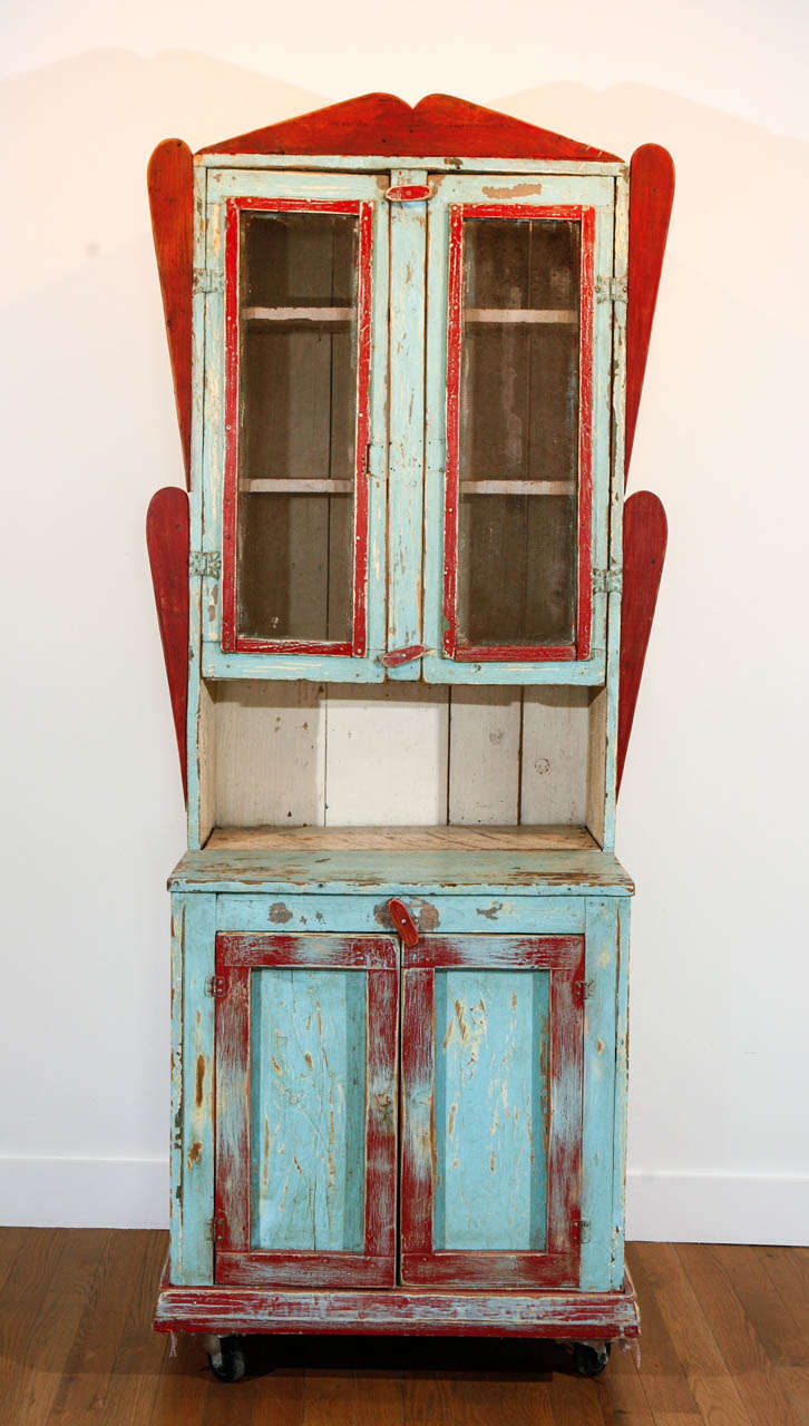 Painted wood cabinet, purchased in New Mexico, of pine and other woods, with wire screening inset in upper doors over interior shelves. Two lower, solid wood doors, over interior shelf of original, antique wood planks. Some minor professional