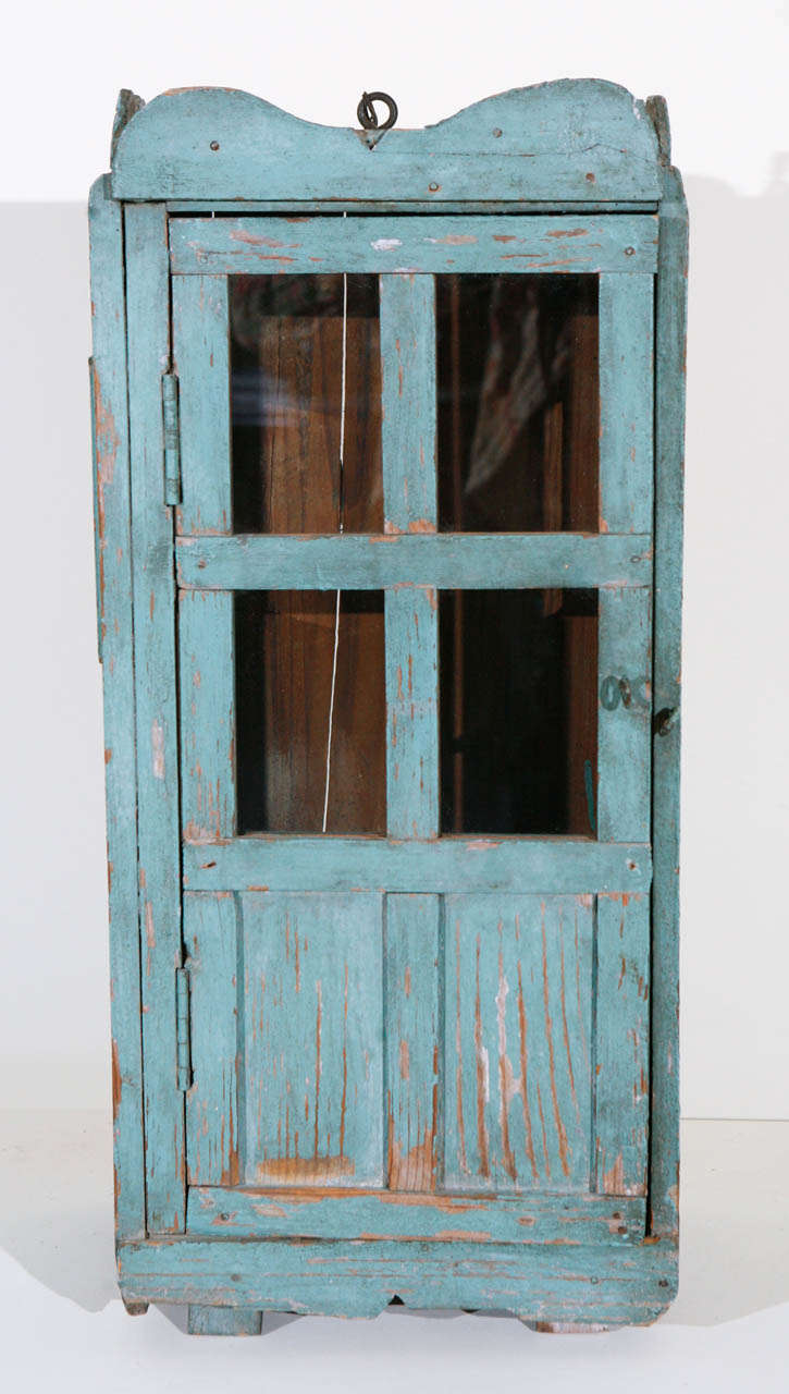 Antique wood cabinet with wood and glazed hinged door. Painted in original  old blue paint - 19th Century, New Mexican Miniature, Painted Wood Cabinet/Nicho For