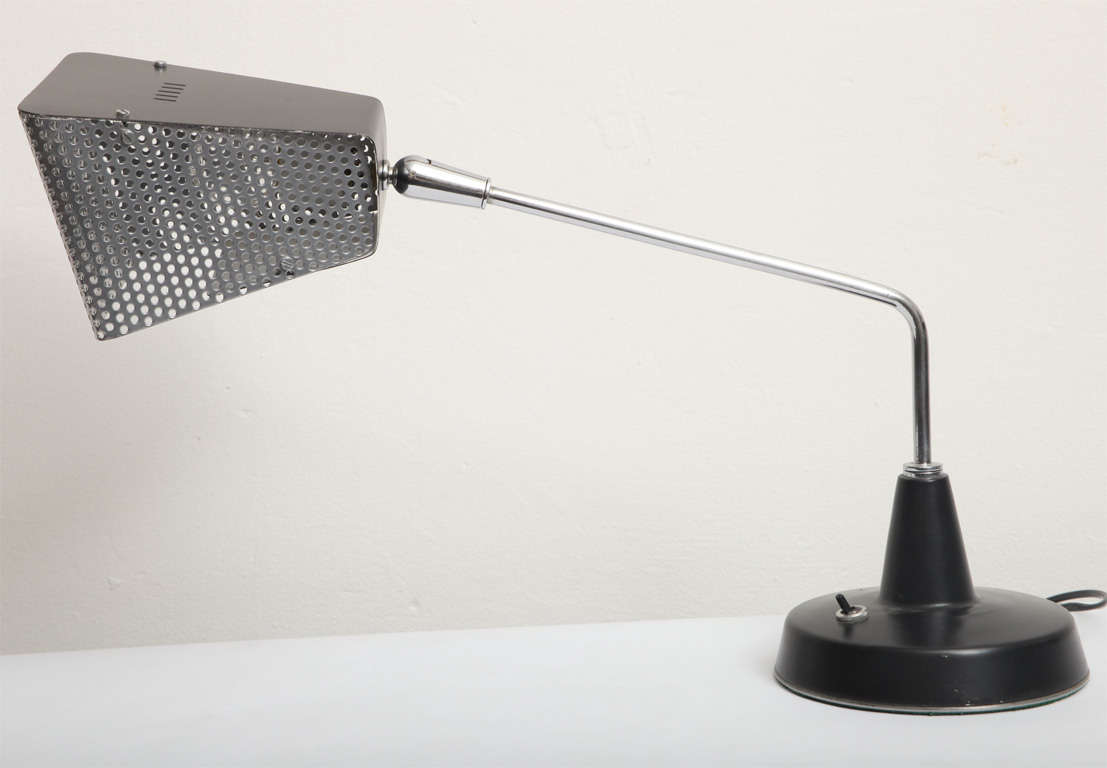 A 1960s Italian articulated table lamp by Stilnovo.
