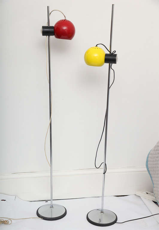 A pair of Italian articulated floor lamps by Regiani.