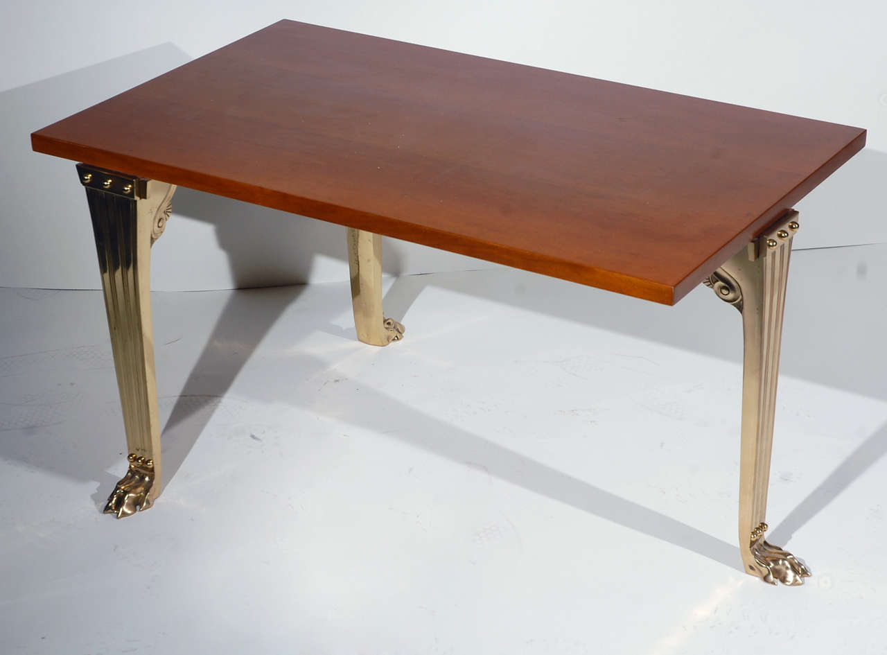 Robsjohn-Gibbings by Saridis Table # 10 with Greek walnut top and three bronze legs joined by stretchers.