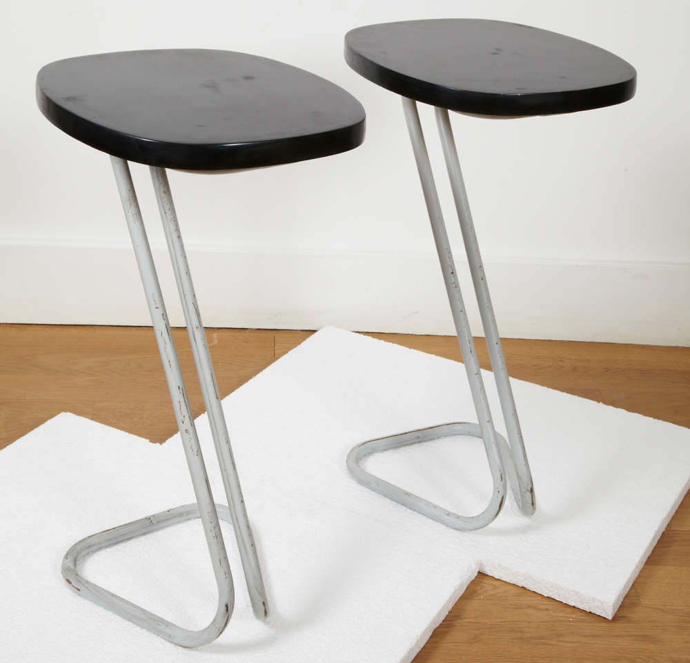 Pair of black lacquered wood side tables or sellettes, resting on a Z grey patinated tubular metal base. Stamped underneath. There is a third red one. André Bloc (1896-1966) French architect and designer, art magazines editor, created a few