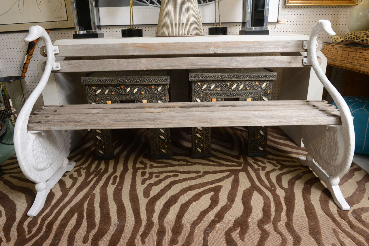 Exquisite all original cast iron swan garden bench. Swans are painted white and wood planks are in their original weathered finish.