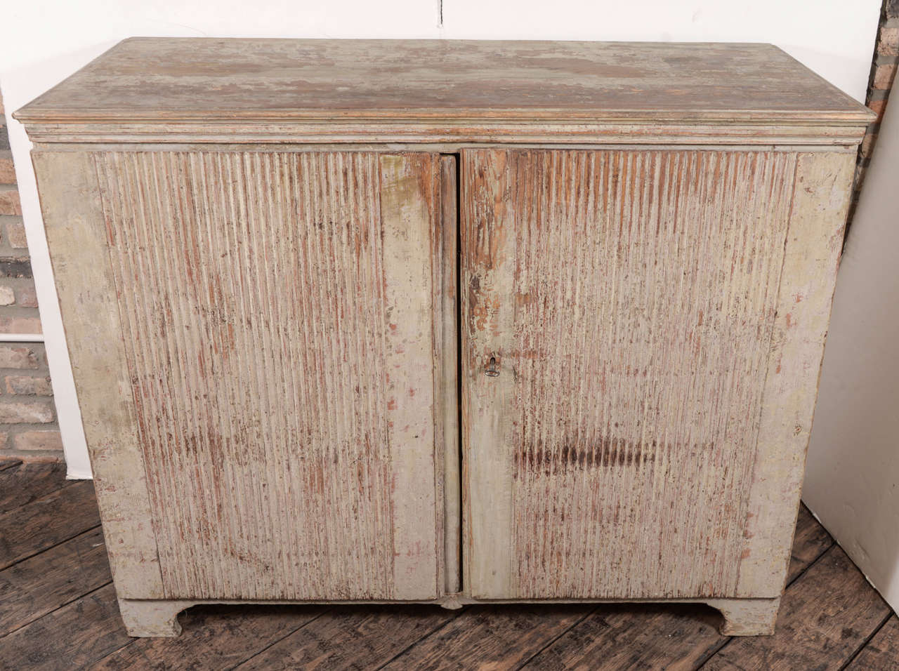 Simple but elegant Swedish Gustavian buffet, reeded doors and scraped to the original paint.