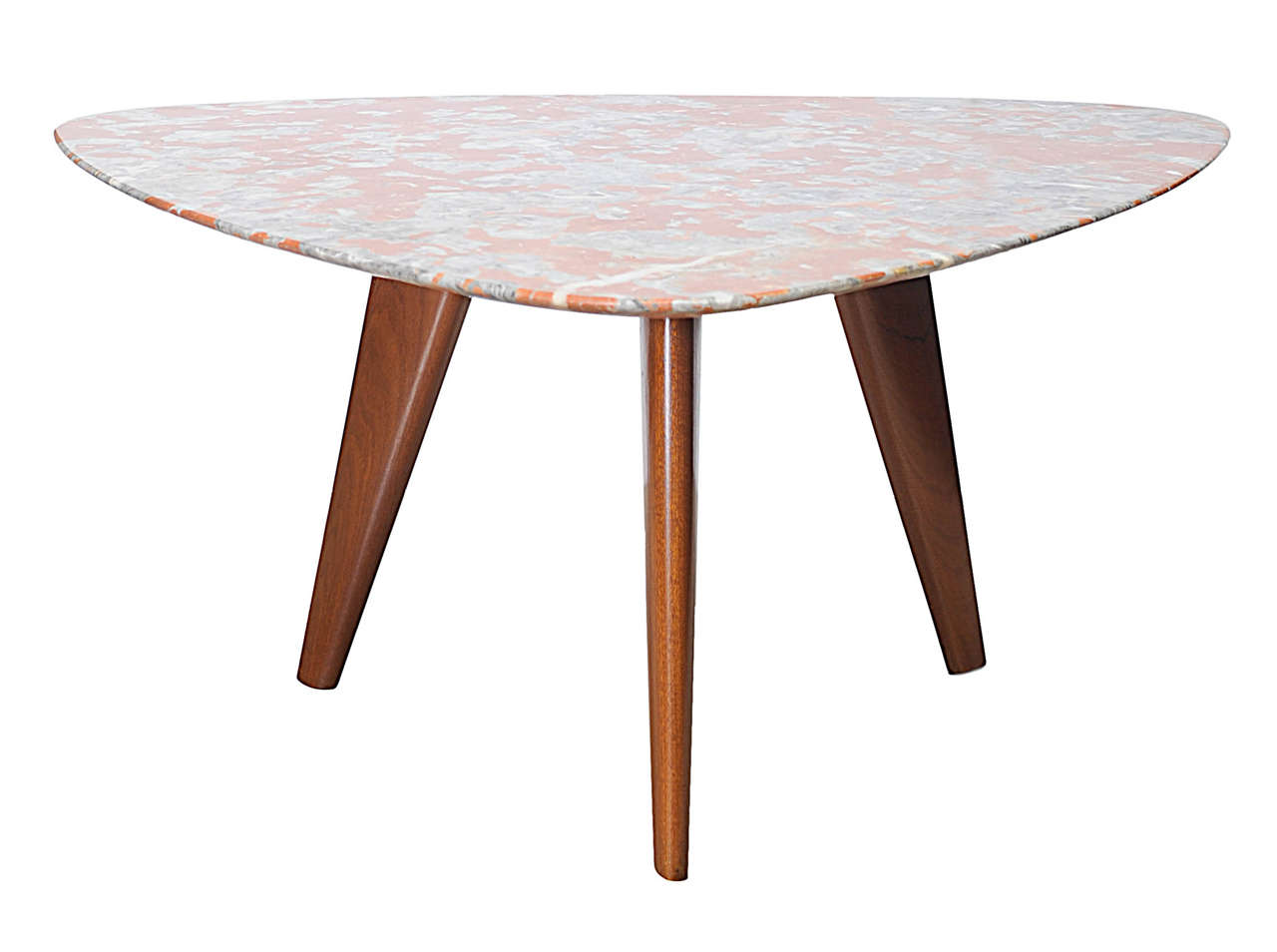 Low table with triangular shape marble top.
