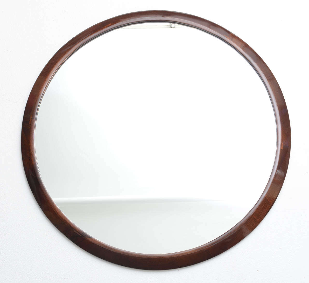 large round french art deco mirror with beveled mahogany