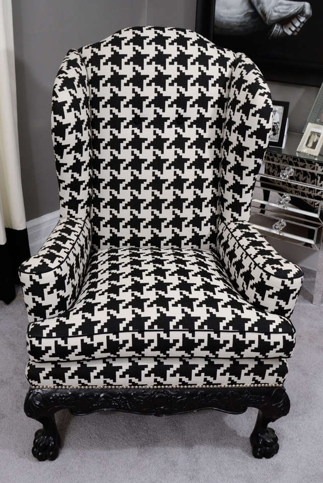 Ball and claw English wing chair in houndstooth with nickel nailhead details.