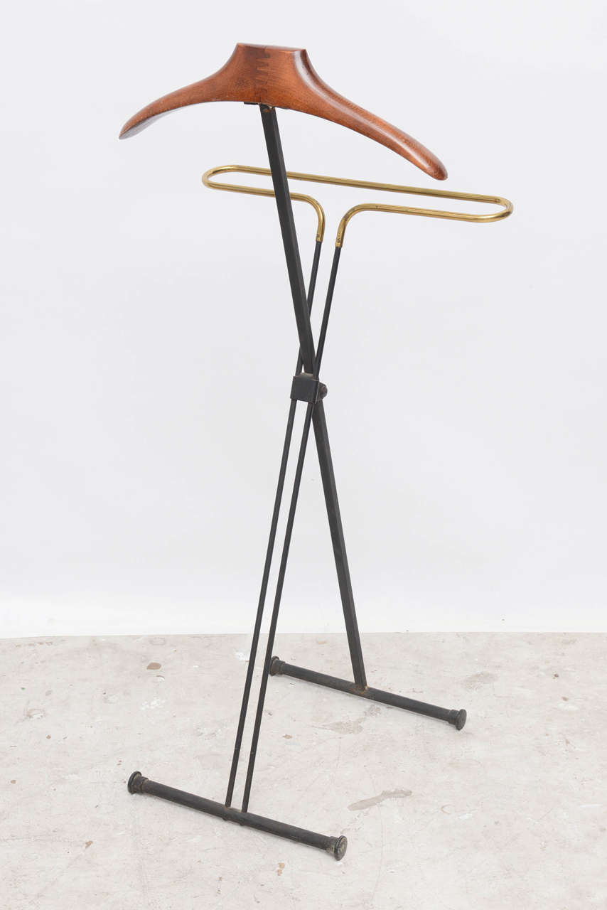 Mid-Century Modern French men's valet stand/coat stand made out of mahogany and metal.