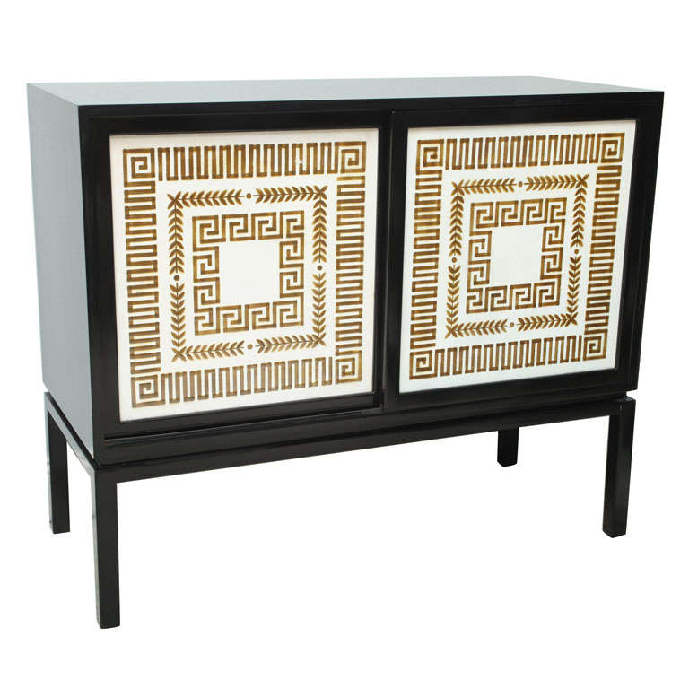 A Black Lacquer Credenza with Sliding Doors, Hollywood Regency
